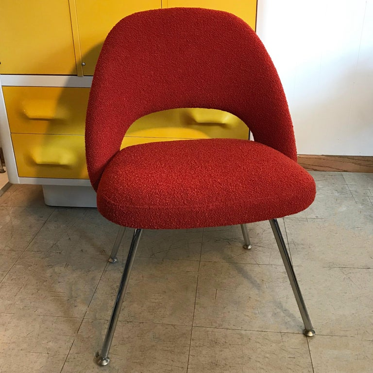 Mid-Century Modern, armless side chair by Eero Saarinen for Knoll features chrome legs with original glides and is newly upholstered in paprika red, nubby wool blend fabric.