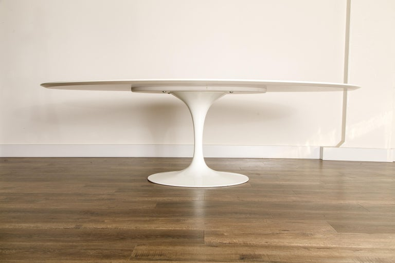 This oval Eero Saarinen for Knoll 'Tulip' pedestal dining table is the largest of the sizes they make, 96