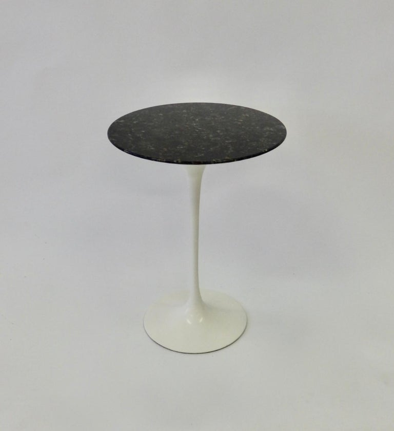 Early Knoll cast iron base with custom ordered black stone top. Eero Saarinen for Knoll Tulip group table.