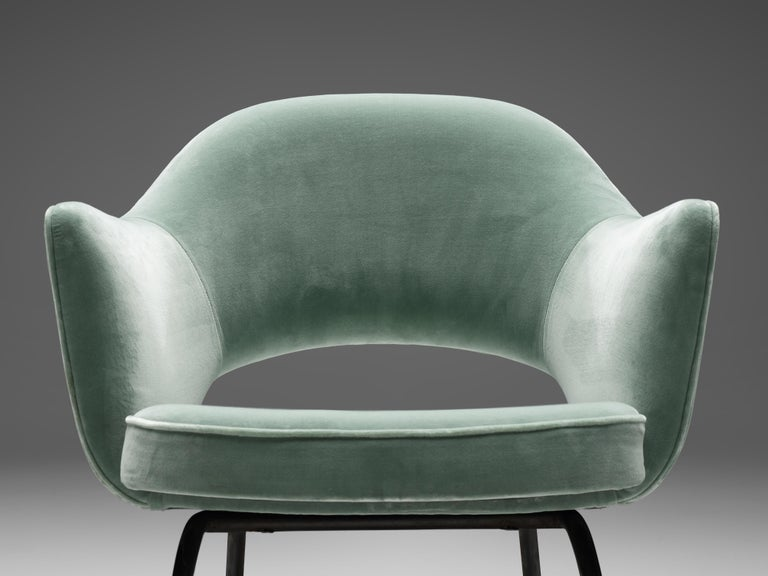 Eero Saarinen for Knoll International, pair of armchairs, in metal and velvet, United States, 1970s.   Pair of iconic armchair designed by Eero Saarinen for Knoll International. A fluid, sculptural form. This organic shaped chair has a timeless and
