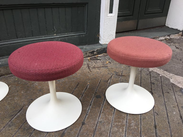 Eero Saarinen for Knoll swivelling tulip stools original paint. Cushions redone about 15 years ago. Bought from original owner who purchased them in the 1950s . Priced individually your choice.