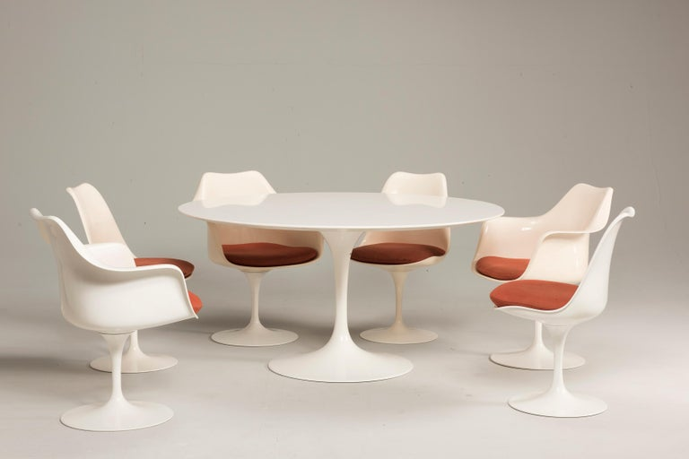 Available 6 tulip chairs from the Pedestal series designed in 1961 by Eero Saarinen for Knoll with original labels. The chairs still have the original cushions. Blue pillows are also available. Good storage conditions, with signs of previous use