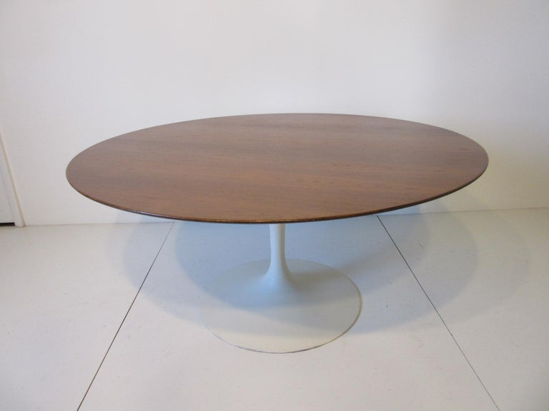 A very rare tea height tulip table or lower tulip dining table special ordered with a teak wood top and satin white cast metal base, retains the manufactures label - Knoll International Park Ave. NY, NY. Perfect for lower styled sitting arrangements