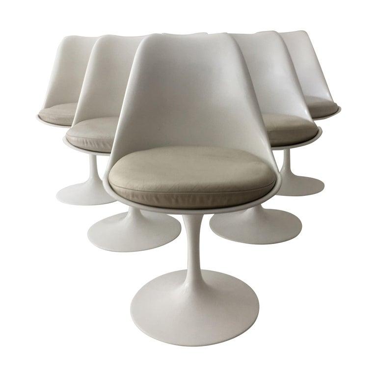 Set of six Eero Saarinen Tulip armless swivel chairs, 1970s, offered by MARKTMODERN