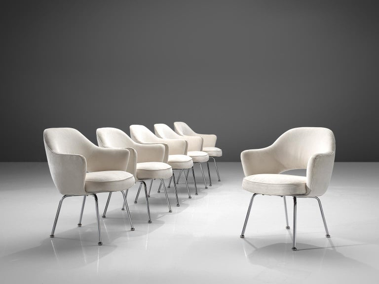 Eero Saarinen for Knoll International, set of six chairs model 71A, in metal and off-white fabric, United States, 1948.   Four iconic armchairs designed by Eero Saarinen. This iconic model is reupholstered in a off white fabric. The chairs feature