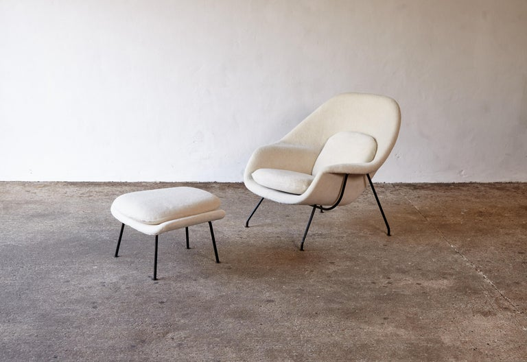 Eero Saarinen womb chair and ottoman, made by Knoll, USA, 1950s-1960s. Early production with black enameled steel frame. Newly and expertly reupholstered in Alpaca.     Fast shipping worldwide - please contact us for a competitive quote.