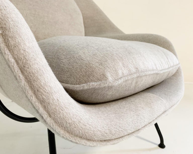"""""""Eero Saarinen designed the groundbreaking womb chair at Florence Knoll's request for 'a chair that was like a basket full of pillows - something she could really curl up in.' This midcentury Classic supports countless positions and offers a"""