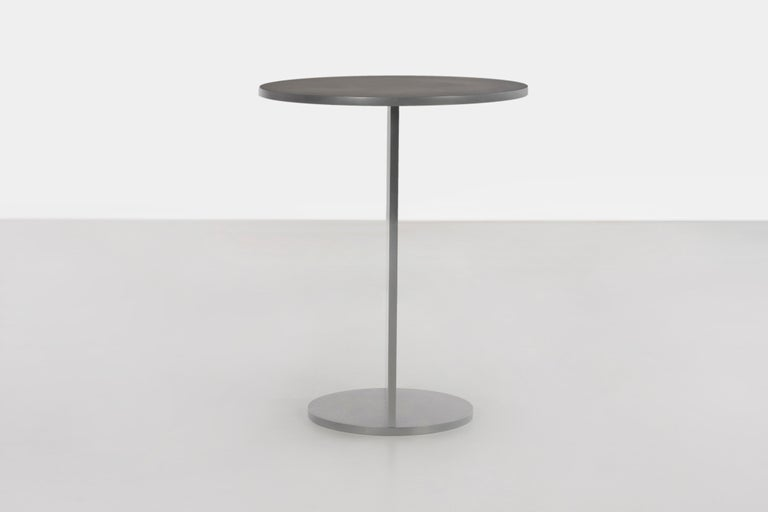 Eero table in half-inch thick wax-polished aluminum. A minimal design in half-inch, mechanically-fastened aluminum plate with a protective coating of wax. Also available in brushed, sanded, anodized, galvanized or polished finish. Signed, dated and