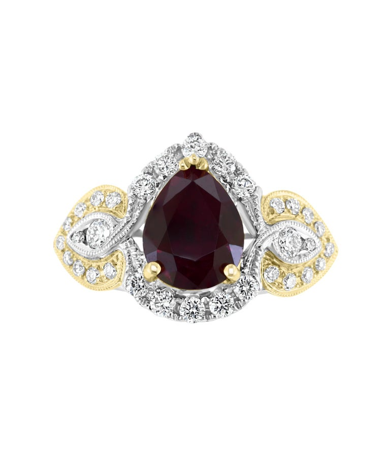 This Effy Hematian design ring is set in 18K White and Yellow gold. Featuring for the center stone a Pear shape Ruby with a weight of 3.18 ct. Surrounded by round cut Diamonds weighing 0.91 ct..  The ring is a size 7. The item number is 17097.