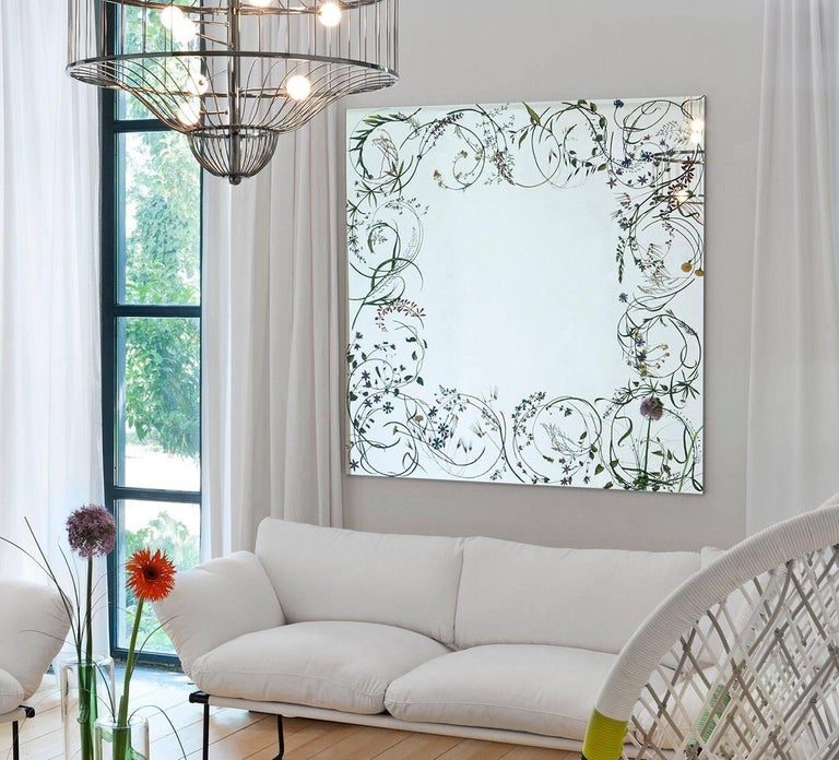 Wild herbs moved by a delicate breeze, frame, lightly and gently, a square mirror, making any space a place in which one can enjoy elements of nature.