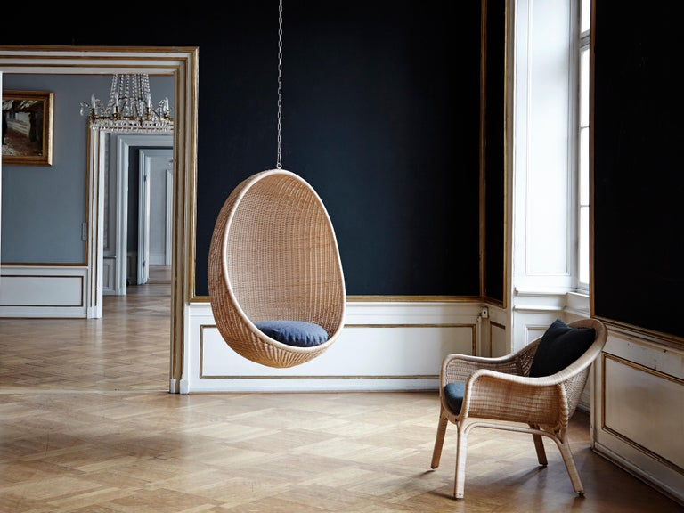 Egg Hanging Chair. Hanging egg is designed by Nanna Ditzel, and is in itself a design icon in Danish Design. Originally the swing was produced in rattan, but for our exterior collection we have used materials which can stand all weather, so you can
