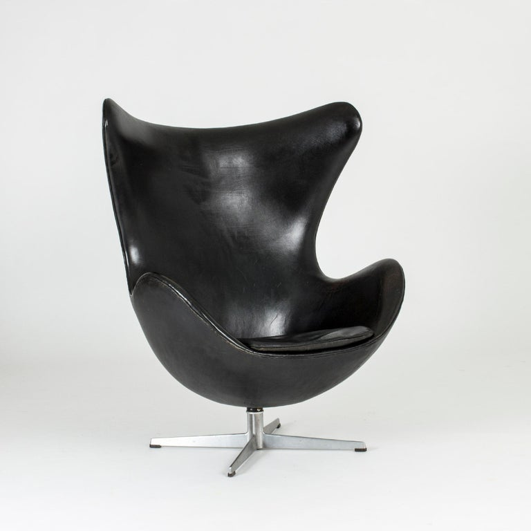 "Iconic ""Egg"" lounge chair by Arne Jacobsen, upholstered with black leather in very good condition. This design was originally made for the SAS Radisson Hotel in Copenhagen in 1958."