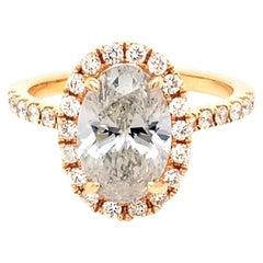 EGL 2.20 Carat E/SI2 Oval Shape Diamond 18 Karat Pave Set Ring with Halo