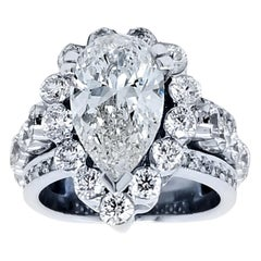 EGL 3.04 Carat G/SI3 Pear Shape Diamond 18 Karat Engagement Ring with Halo