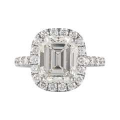 EGL 3.99 Carat Emerald Cut Diamond Ring with an Eternity Band 18k White Gold
