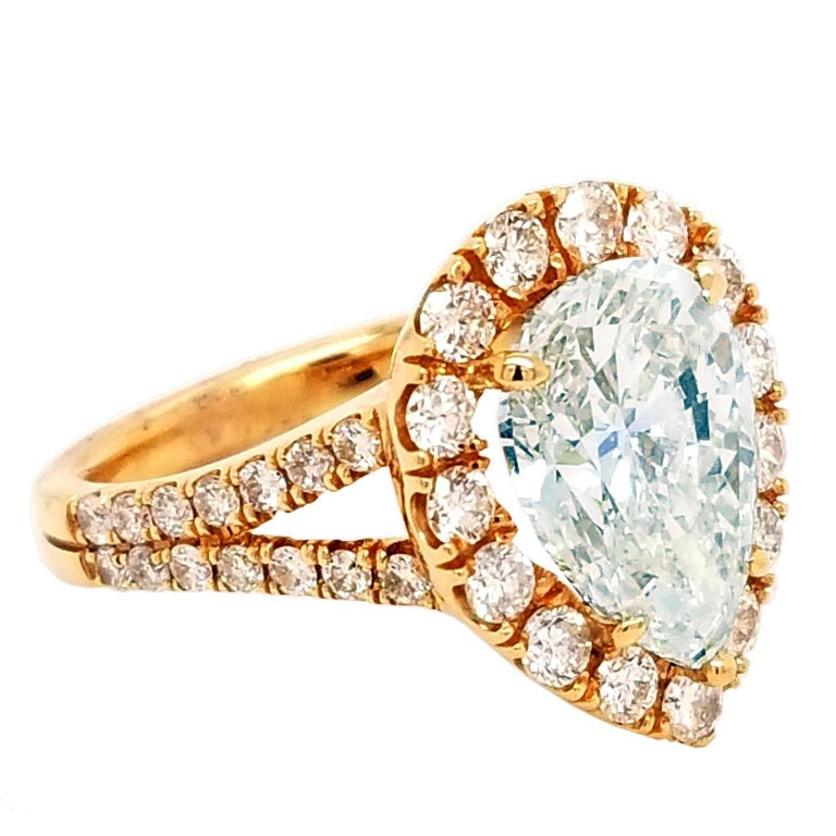 A very fine  Oval Shaped I/VS2 EGL certified center Diamond set in a fine 18k Rose gold Split Shank Pave set engagement Ring with halo and total diamond weight of 1.21 Ct. on the side.   Diamond specs: Center stone: 4.01 Ct EGL Certified I/VS2 Pear