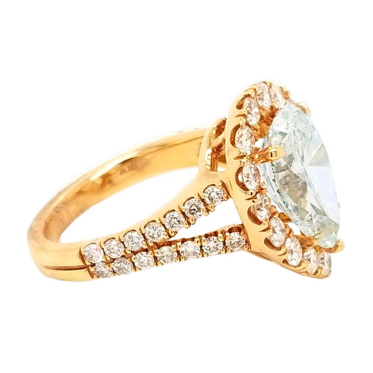 Contemporary EGL 4.01 Ct I/VS2 Pear Shape Diamond 18K Split Shank Pave Set Ring with Halo For Sale