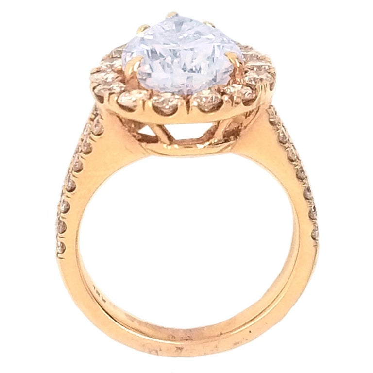 EGL 4.01 Ct I/VS2 Pear Shape Diamond 18K Split Shank Pave Set Ring with Halo In New Condition For Sale In Los Angeles, CA