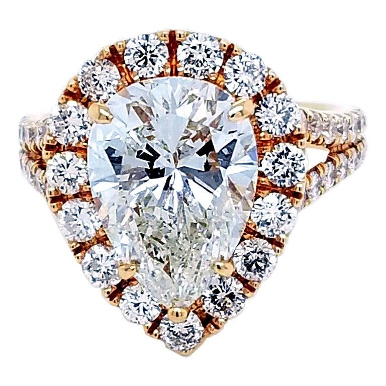 EGL 4.01 Ct I/VS2 Pear Shape Diamond 18K Split Shank Pave Set Ring with Halo For Sale