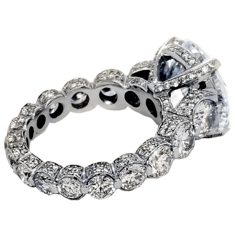 Contemporary EGL 7.01 Ct Round Diamond 18K Shared-Prong Set Eternity Style Engagement Ring For Sale