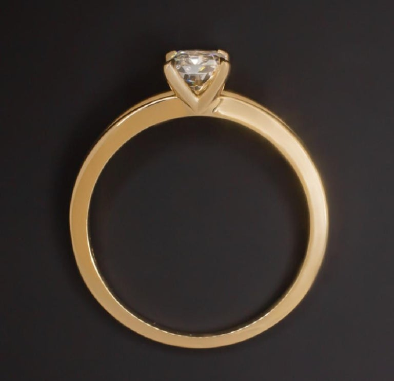 elegant ring pairs a 1 carat radiant cut certified diamond with a sleek split shank design. Beautifully white and exceptionally clean with VS1 clarity, the diamond displays fantastic, bright and lively brilliance. The diamond is paired with a split