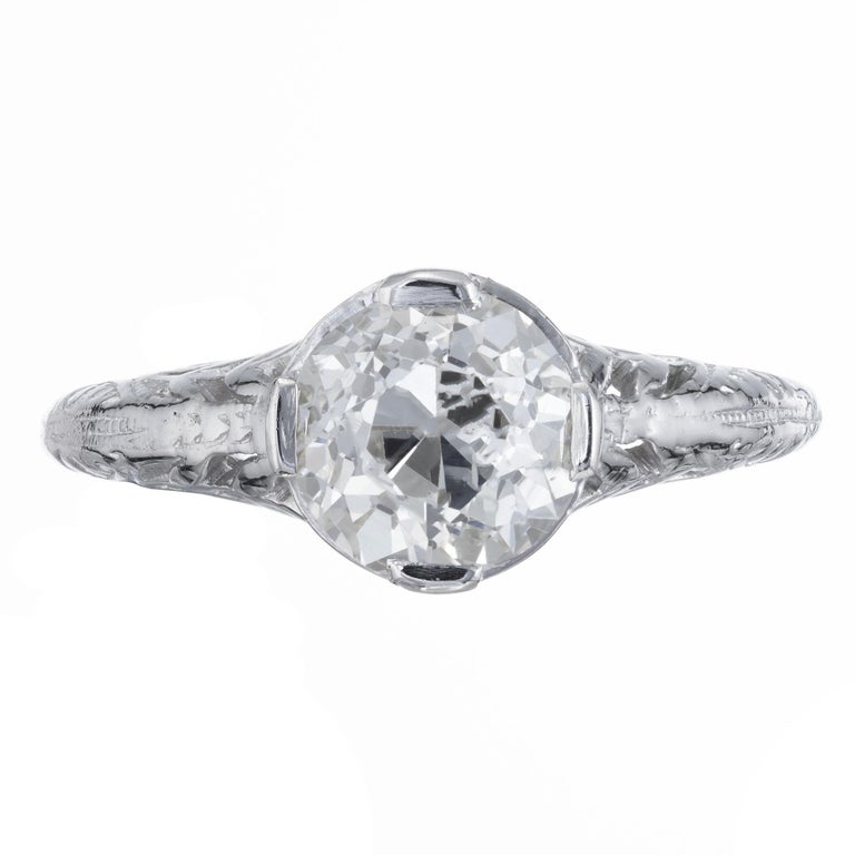 Art Nouveau diamond engagement ring. Handmade Platinum setting with an EGL certified old European cut center diamond.  ring circa 1900 with simple pierced design.     1 old European cut diamond, approx. total weight 1.36cts, O to P color and VS1