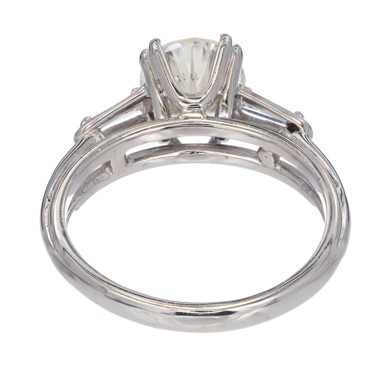 Round Cut EGL Certified 1.51 Carat Diamond Baguette Gold Three-Stone Engagement Ring For Sale