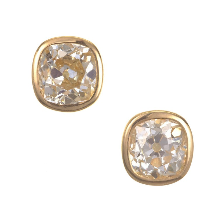 Old mine brilliant cut diamond stud earrings. Set in 18 yellow gold bezel baskets. EGL Certified  1 Old Mine Cut Diamond Approx. Total Weight 1.46 carats L-M, SI2 EGL Cert. US400120263D 1 Old Mine Cut Diamond Approx. Total Weight 1.45 carats M-N,