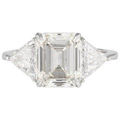 Alexander EGL Certified 2.85 Carat Emerald Cut Diamond Three-Stone Ring 18k