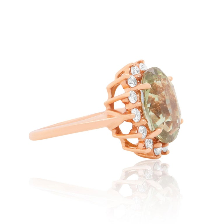 Metal: 14K Rose Gold  Center Stone: 1 EGL Certified Oval Alexandrite at 4.91 Carats - Measuring 12.17 x 8.88 x 5.71 millimeters Side Stones: 14 Round Brilliant White Diamonds at 0.55 Carats Total Weight  Alberto offers complimentary sizing on all