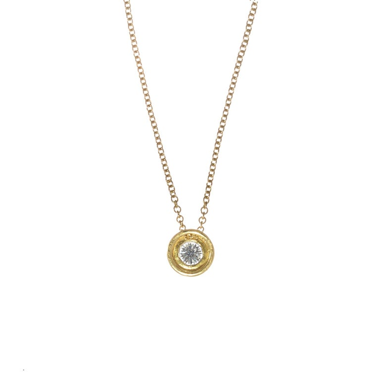 EGL certified 0.55 carat diamond bezel set slide pendant in 18k yellow gold.  1 round brilliant cut diamond G-H SI, approx. .55ct 18k yellow gold  Stamped: 750 18k 4.8 grams Chain: 18 Inches Width: 9mm Thickness/depth: 4.9mm