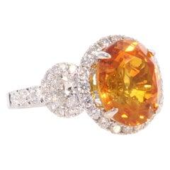 EGL Sri Lanka Certified 6.60 Carat Oval Orange Sapphire & Diamond Cocktail Ring