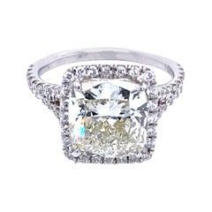 EGL US 4.06 Carat K/SI1 Cushion Platinum Pave Set Diamond Ring with Halo