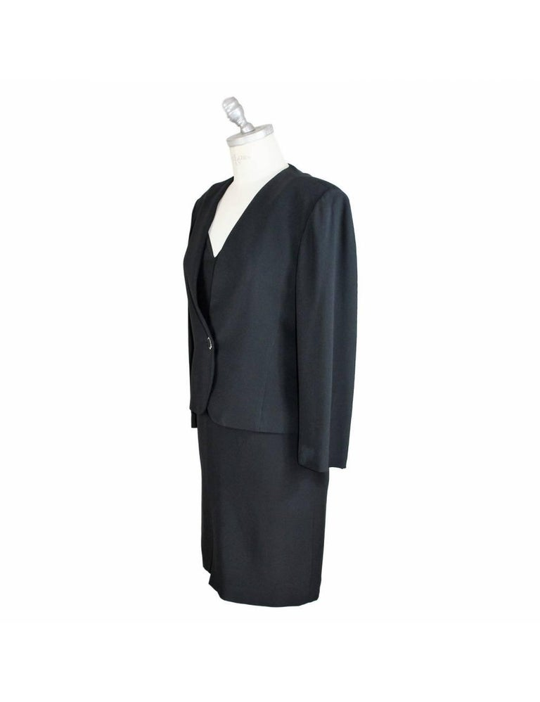 Vintage suit dress Egon Von Furstenberg brand, black, 100% viscose. The suit consists of dress and jacket, the sheath dress with shoulder pads covered with stones, the jacket closes with a jewel button. 90s. Made in Italy. Excellent vintage