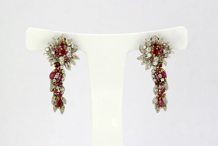 18kt yellow gold ladies clip-on earrings with diamonds & rubies. Egyptian 18kt gold hallmarks. Made in Egypt Circa 1970's  Dimensions - Size : 3.8 x 1.8 x 1.4 cm Weight : 15 grams total  Rubies -  Cut : Round / Marquise Total number of rubies :