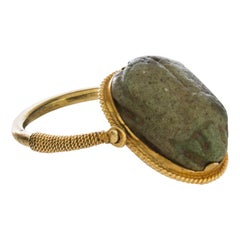 Egyptian 22kt Gold Round Wire Ring with Flip Bezel Holding Faience Scarab Amulet