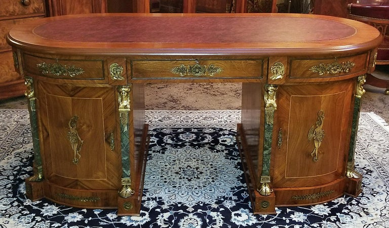 Presenting a fabulousEgyptian Classical Revival desk from the mid-20th century.  From circa 1970.  This is what is known as an Egyptian made desk in the neoclassical revival style, complete with ormolu neoclassical figures and heads, marble
