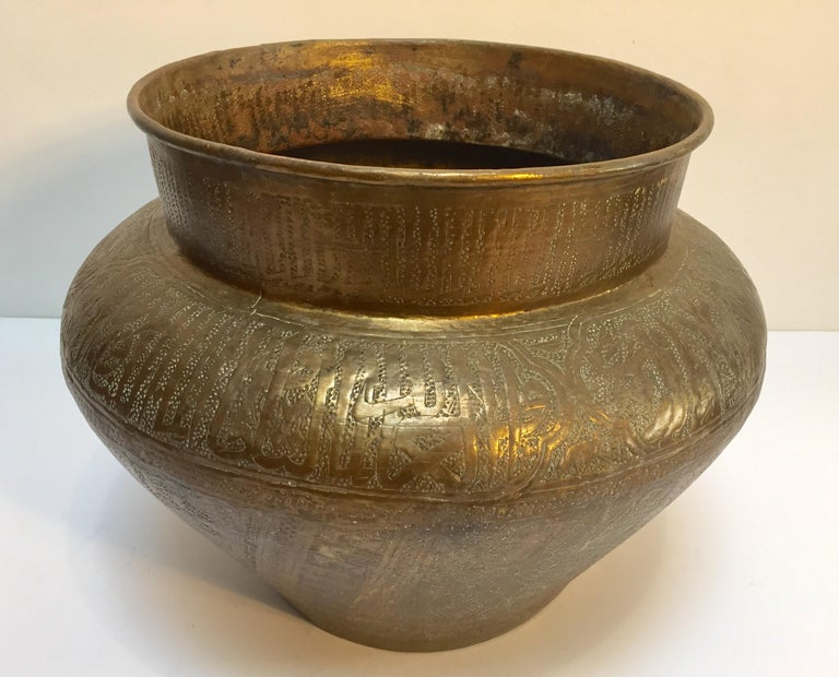 Middle Eastern 19th century large scale Jewish Egyptian finely hand etched brass memorial bowl decorated with medallions with Hebrew inscriptions, pyramids, sphinx, and human figures, the motifs are from the period of slavery in Pharaonic