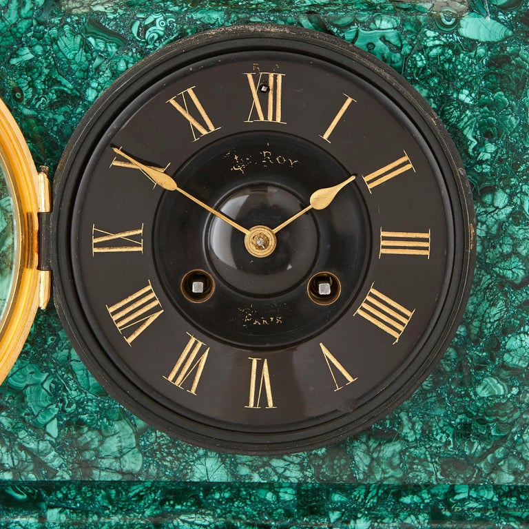 This magnificent clock set is signed 'Le Roy', most likely for Le Roy et fils. Founded in 1785, Le Roy et fils was an acclaimed French clock-making firm, which was run by Basile Charles Le Roy in partnership with his son, Charles-Louis Le Roy. Le