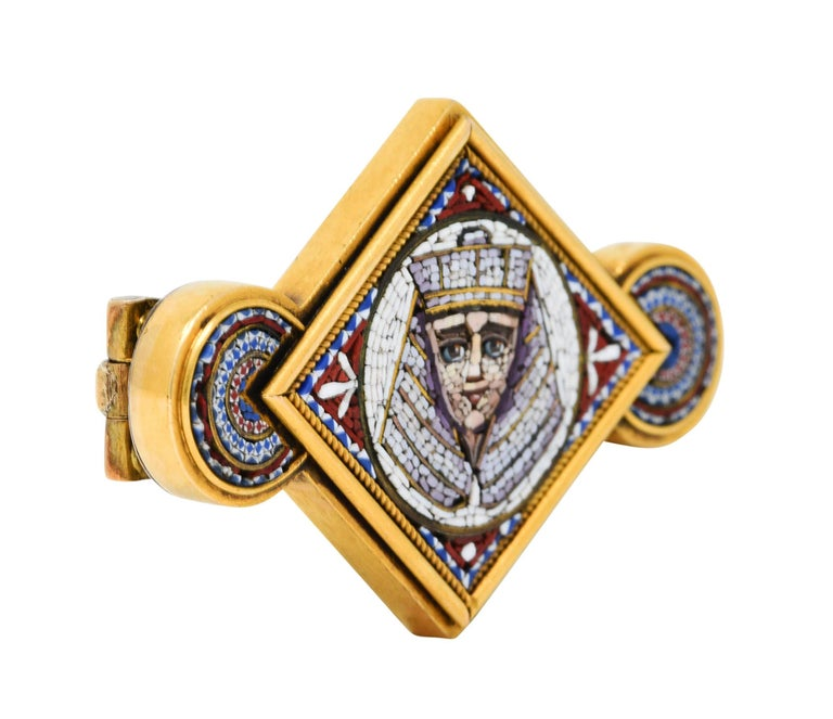 East to West brooch centers a navette form flanked by circular forms  Depicting an ornate micro mosaic image of a Pharaoh and intricate concentric patterning  With a subtle twisted rope surround  Completed by a pin stem and closure  Tested as 18