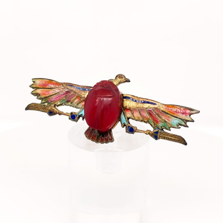 This pin is quite the piece! This Egyptian Revival pin features a lovely scarab in the center made of carved carnelian! The wings on this eagle are gorgeous plique-a-jour enamel - a technique that makes the final product translucent! As there is no