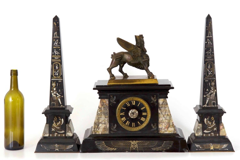A powerful expression of the cultural curiosity in the mysteries and discoveries of ancient Egypt during the late 19th century, this very finely decorated clock is incised with a full array of hieroglyphics and Egyptian motif. The mantel clock is