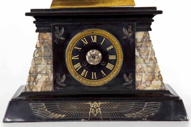 Patinated Egyptian Revival Three-Piece Clock Garniture Flanked, Obelisk France, circa 1880 For Sale