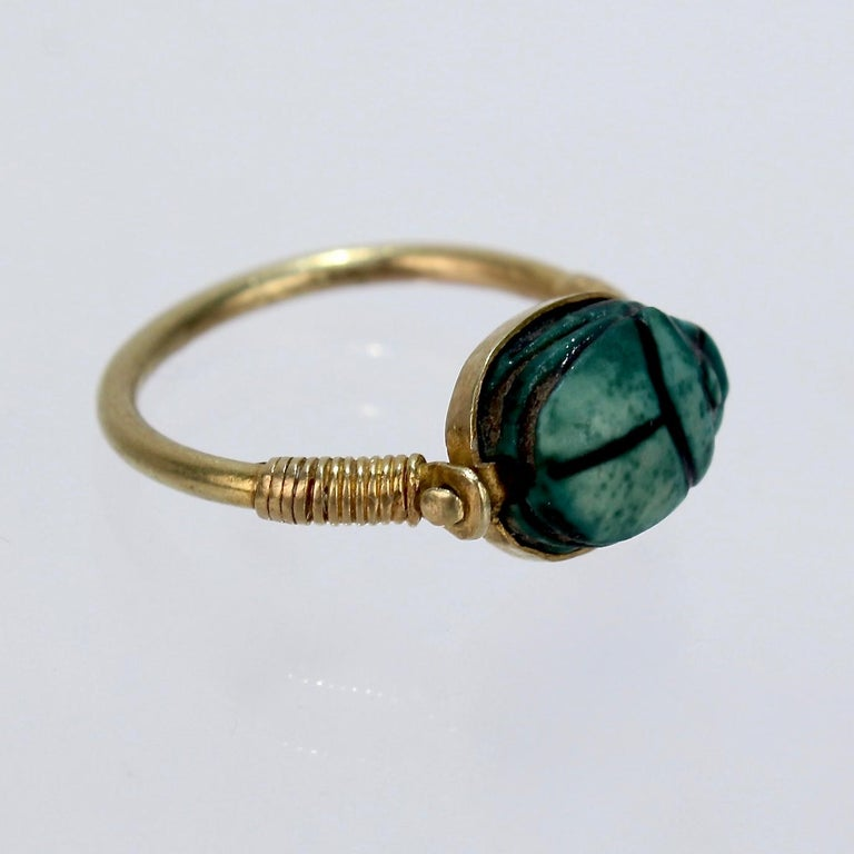A rare antique Egyptian steatite scarab and gold finger ring.  It is accompanyied by a note from the shop of Mohammed Mohasseb & Son from Luxor, Egypt.   The note identifies the ring as 18th Dynasty (about 1500 BCE), bearing the name of Amen-Ra -
