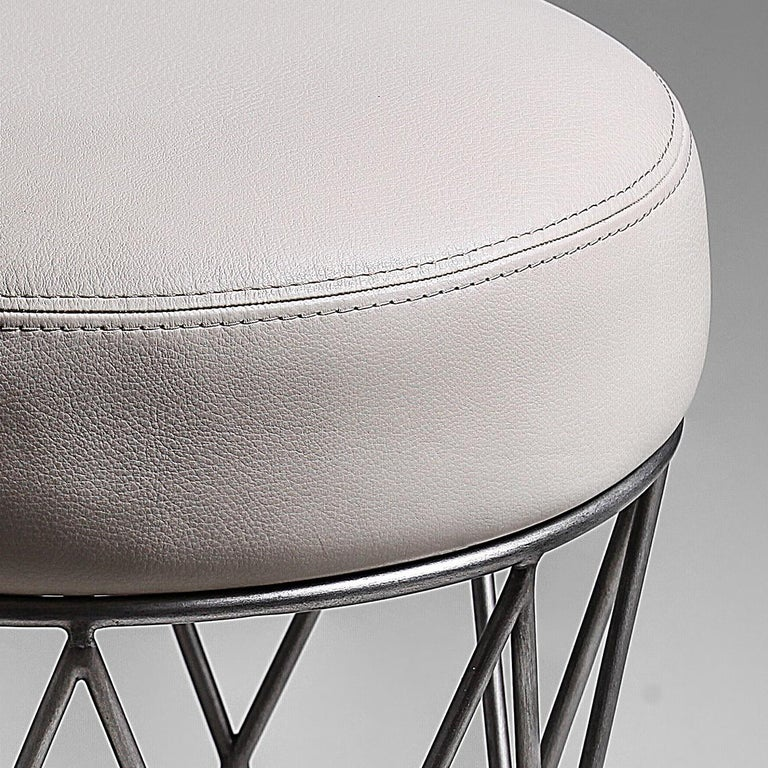Modern Eiffel, Ottoman in Hand Patinated Silver Leaf and Upholstered Seat For Sale
