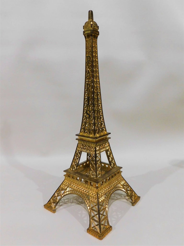 Eiffel Tower Paris France with gilt metal display stand model souvenir. Nice architectural copy.  Eiffel tower (French: La Tour Eiffel) was built in 1889 and is located on the Champ de Mars in Paris, France. Hollow structure tower, 300 meters