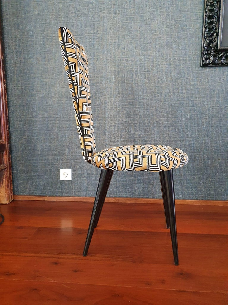 Midcentury set of eight (8) Mid-Century Modern black lacquered legs by Umberto Mascagni, 1950s this beautiful Classic midcentury chairs with conical wooden legs are lacquered in black. The wooden chairs are covered Aldeco fabric, the chairs have a