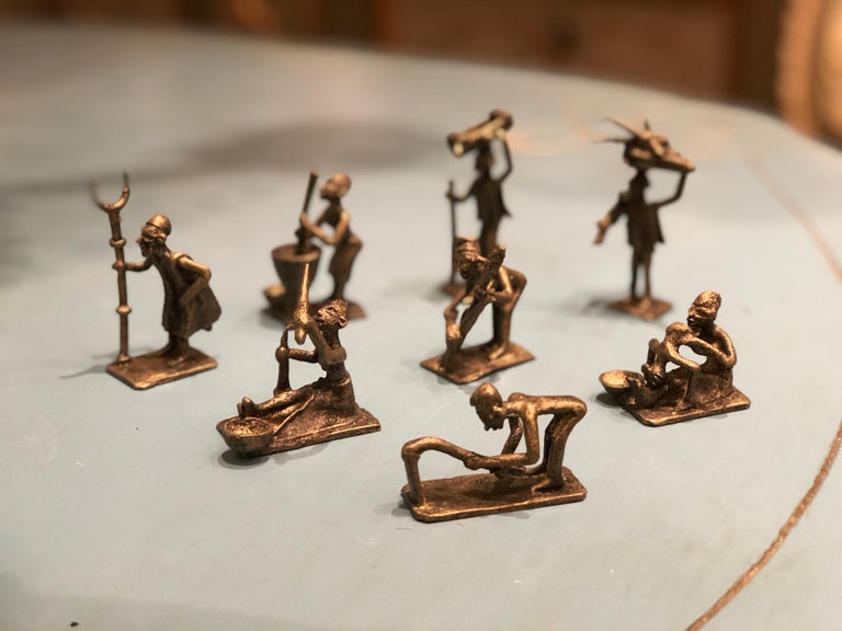 Antique African small bronze figures representing different human activities. Eight pieces -each one with different size between 5/5 and 5/10 cm.