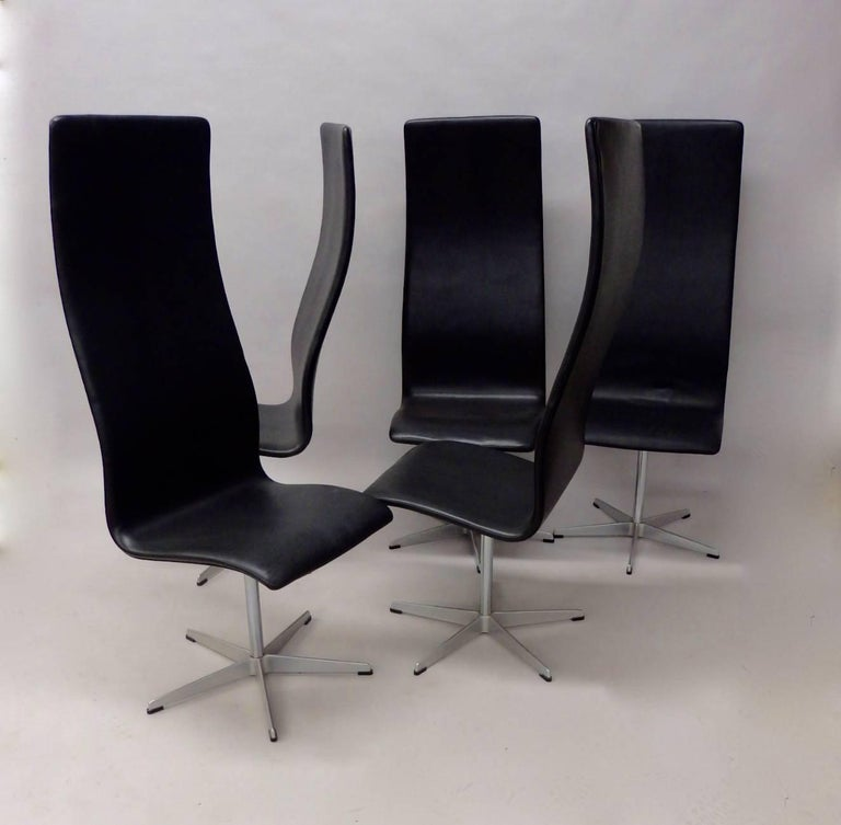 Danish Eight Arne Jacobsen Black Leather Oxford Tall Dining Chairs For Sale