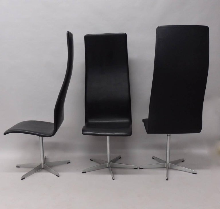 Eight Arne Jacobsen Black Leather Oxford Tall Dining Chairs In Good Condition For Sale In Ferndale, MI